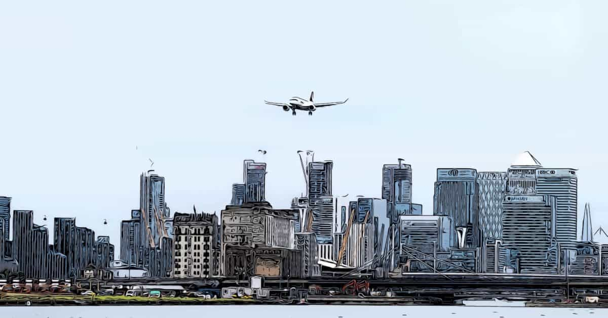 canary wharf transport links showing plane landing at london city airport canary wharf background