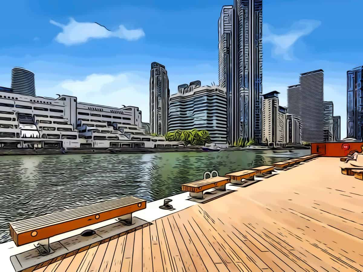 swimming in canary wharf boardwalk water view towards south quay plaza