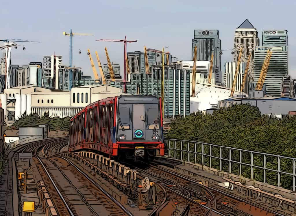 dlr train with canary wharf in the background
