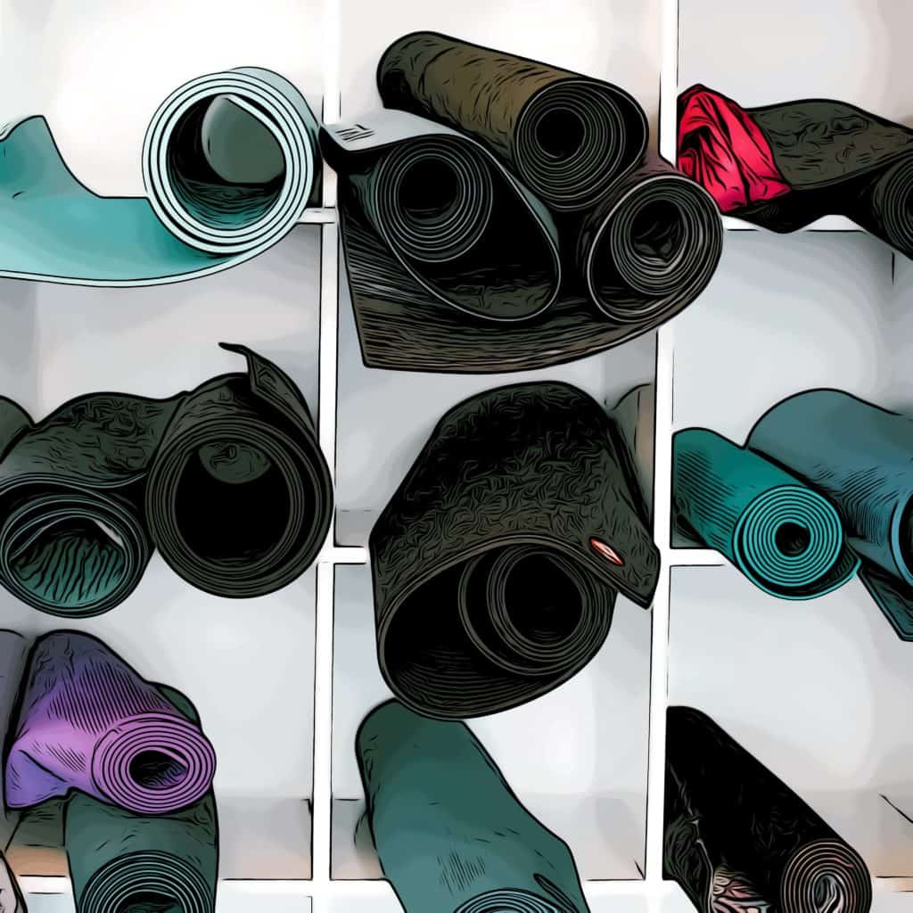 yoga mats stacked before a hot yoga class in canary wharf