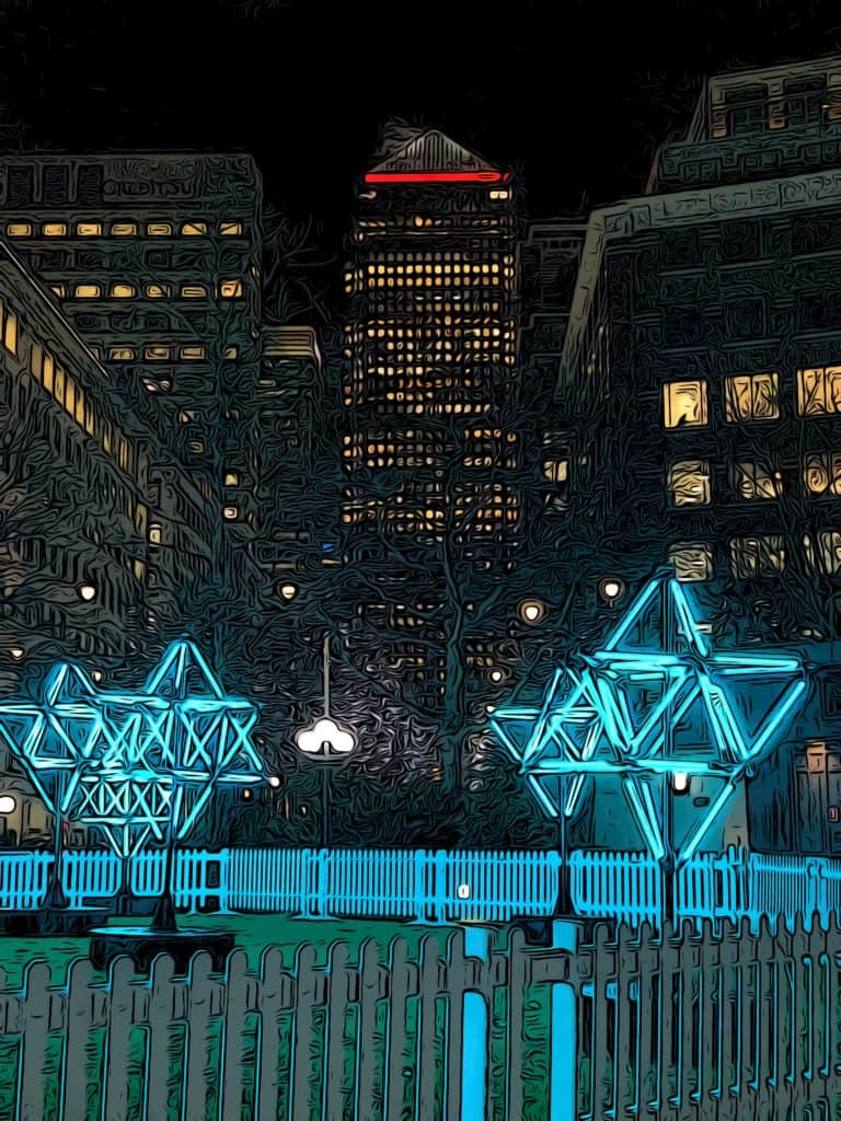 2021 connected by light festival exhibit showing lit up stars in front of One Canada Square in Canary Wharf