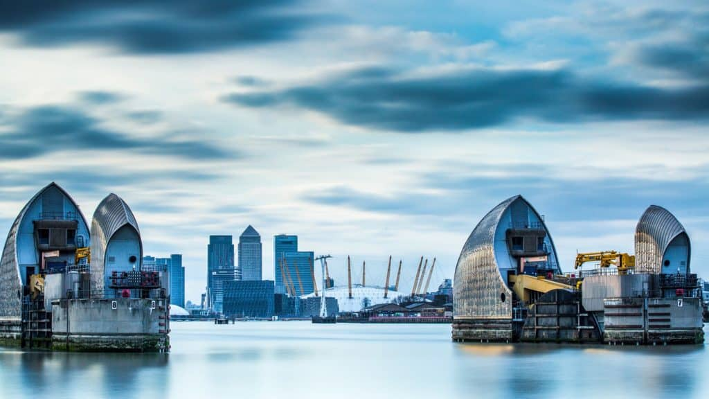 view of canary wharf from the thames barrier