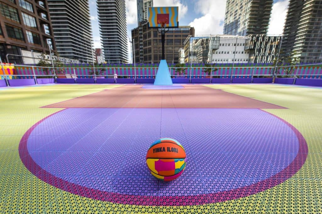 pop-up basketball court in canary wharf designed by yinka ilori with limited edition basketball
